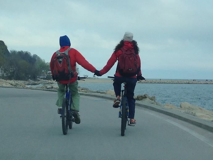 bikers holding hands